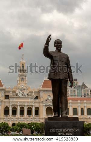 Ho Chi Minh City, Vietnam. 24 February, 2016. The former city hall of Saigon was built during the French colonial period.. Today it houses government offices. A statue of Ho Chi Minh stands in front.  - stock photo