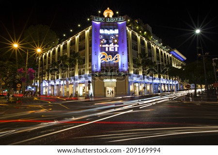 HO CHI MINH CITY, VIETNAM - JAN 29: Legendary Rex Hotel by night on January 29, 2013 in Ho Chi Minh City. The roof top bar of Rex Hotel was a hangout for war correspondents during the Vietnam war. - stock photo