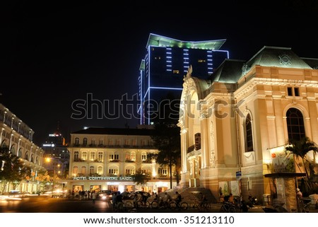 HO CHI MINH CITY, VIETNAM- Jan 20, 2015: Saigon Opera House and the Hotel Continental in the background, both iconic historical landmarks in Vietnam's largest city. - stock photo