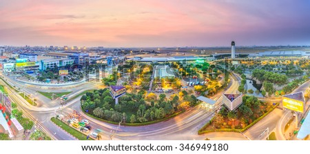 Ho Chi Minh City, Vietnam - January 19th, 2015: Sunset on the Tan Son Nhat airport with purple sky, the lights gradually create the panoramic beauty of the airport in Ho Chi Minh City, Vietnam