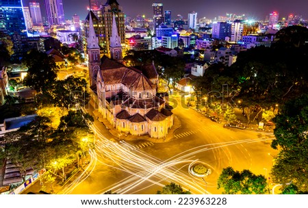 HO CHI MINH CITY, VIETNAM - JULY 3, 2014 - The Saigon Notre Dame Basilica & the surroundings by night. The cathedral was constructed between 1863 & 1880.and has become a very famous building in HCMC. - stock photo