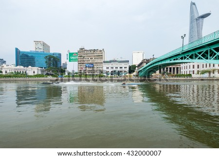 Ho Chi Minh City, Vietnam - June 03, 2016: Downtown of Ho Chi Minh City central with Historical Mong Bridge and Khanh Hoi Bridge, connect traffic between District 1 and District 4.