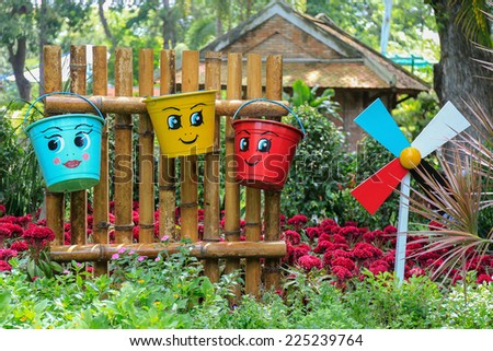 HO CHI MINH CITY / VIETNAM JUNE 28 2014 : painted smile faces on bukets in the garden of Vietnam's largest Saigon Zoo and Botanical Gardens ( Thao Cam Vien ) at downtown of Ho Chi Minh City, Vietnam - stock photo