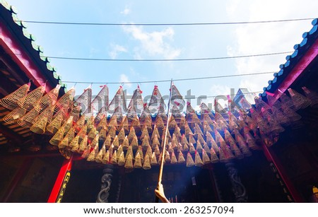 HO CHI MINH CITY, VIETNAM - 05 MAR, 2015: Spiral Incense hanging on in Thien Hau pagoda temple in Ho Chi Minh City, Vietnam - stock photo
