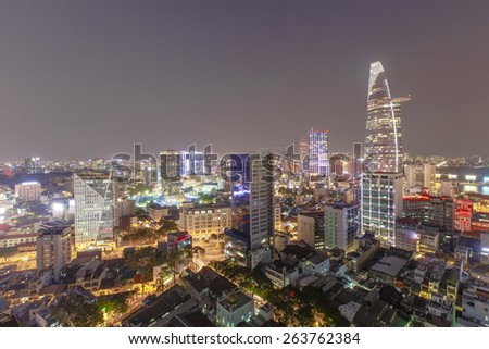 HO CHI MINH CITY, VIETNAM - MARCH 17, 2015 : Saigon riverside by night view on high at downtown center with buildings across riverside Saigon river Ho Chi Minh City - stock photo