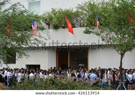 HO CHI MINH CITY, VIETNAM, MAY 25, 2016, Crowds Waiting, Entrance, Building, President Barack Obama Visit, Country Flags, Green Trees, Documentary Editorial