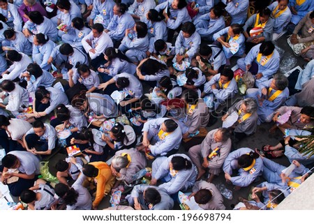 HO CHI MINH CITY, VIETNAM- MAY 5: Impression overview with overcrowded of buddhist in grey dress uniform, sitting on yard of Pagoda on anniversary of buddha's birthday, Saigon, Viet Nam, May 5, 2012