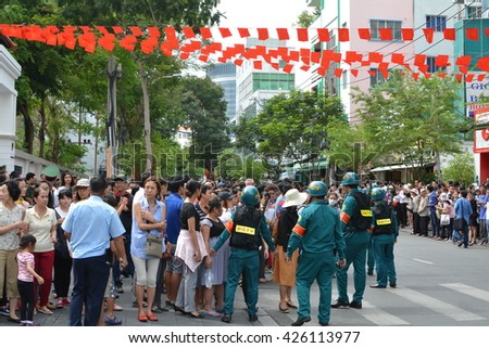 HO CHI MINH CITY, VIETNAM, MAY 25, 2016, President Barack Obama Visit, Crowds Waiting, Red Flags, Road, Street, Security Police, Documentary Editorial
