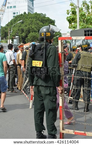 HO CHI MINH CITY, VIETNAM, MAY 25, 2016, President Barack Obama Visit, Security Police, Building Barricades, Fences, Black Uniform, Road, Street, Vertical, Documentary Editorial