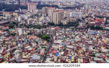 Ho Chi Minh city, Vietnam - NOV 2015 Cityscape of Saigon downtown, viewed from top of building. Saigon (Ho Chi Minh city) is the largest city in Vietnam with population around 10 million people. - stock photo