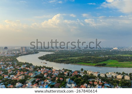 HO CHI MINH CITY / VIETNAM - November 16, 2014 :Saigon when viewed in District 2, with the river curved and high-rise buildings. - stock photo