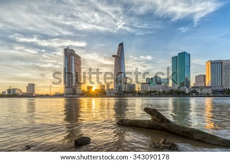 Ho Chi Minh City, Vietnam - November 20th, 2015: Sun star sunset in City with logs as the path to sun rays is lower down the skyscrapers make beautiful sunset in District 1, Ho Chi Minh City , Vietnam