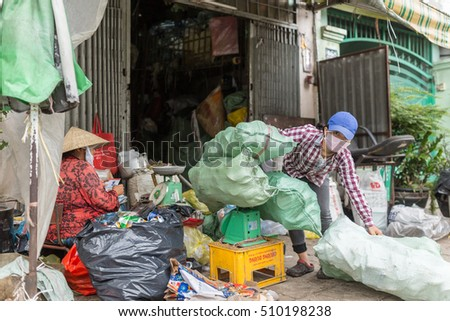 HO CHI MINH CITY, VIETNAM - October 31, 2016: Local people gathering garbage and plastic waste and selling it to recycling factory in Ho Chi Minh City on October 31, Vietnam.