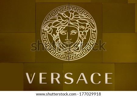 HO CHI MINH CITY, VIETNAM-OCTOBER 31ST 2013: Versace logo on store in Ho Chi Minh City. The logo is based on Medusa who was reputed to be so hideous that men turned to stone when looking at her. - stock photo