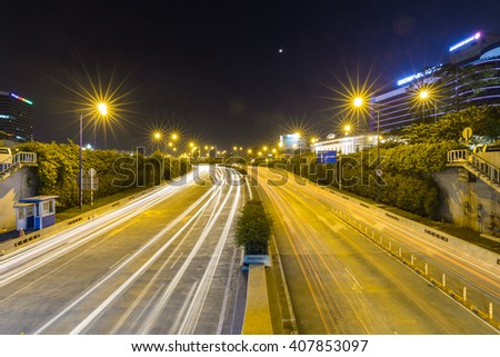 Ho Chi Minh City, Vietnam - October 17, 2015: Vehicles are traveling through the Thu Thiem Tunnel by night from District 2 to District 1, economics and financial area.