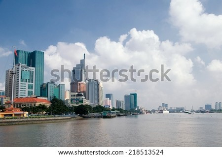 HO CHI MINH CITY, VIETNAM - SEP 20, 2014: Skyscrapers business center looking over Saigon river on Sep 20, 2014 in Ho Chi Minh City, Vietnam.Ho Chi Minh city is the biggest city in Southern of Vietnam - stock photo