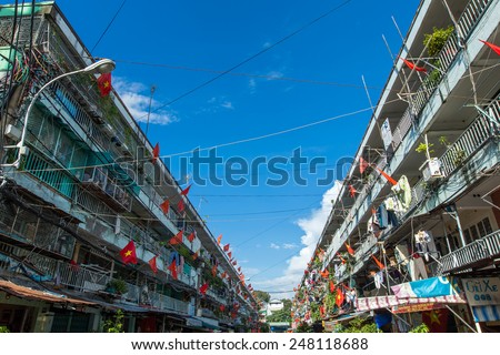 HO CHI MINH CITY/VIETNAM - SEPTEMBER 3 2014 : On Independence Day all people old apartment in Saigon were hanging flag to commemorate this day - stock photo