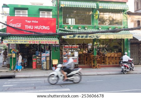 Ho Chi Minh City, Vietnam-29th Oct 2013: A typical street scene. Motorbikes are the main form of transport in the city. - stock photo