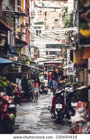 HO CHI MINH - JUNE 14: People and turists walking in the city streets, on June 14, 2015 in Ho Chi Minh, Vietnam - stock photo