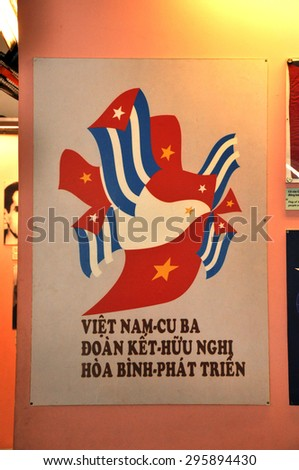 HO CHI MINH - MARCH 7: Propaganda poster of Republic of Cuba, supporting Vietnam against the US in 1966 in the War Remnants Museum. On March 7, 2013 in Saigon, Vietnam - stock photo
