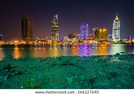 HO CHI MINH, VIETNAM - APRIL 02, 2015. Night view of Business and Administrative Center of Ho Chi Minh city on Saigon riverbank, Vietnam. - stock photo