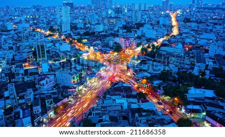 HO CHI MINH, VIETNAM- AUG 14: Amazing panaromic of Asia city, block of house close together, vehicle make yellow trail on street, impression intersection, Sai gon is big town, Vietnam, Aug 14, 2014