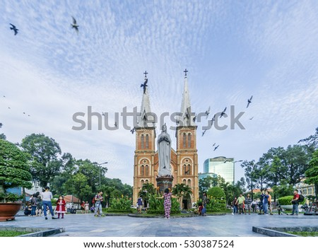 HO CHI MINH, VIETNAM - DEC 15, 2014: Saigon Notre-Dame Cathedral Basilica on blue sky background in Ho Chi Minh city, Vietnam. Ho Chi Minh is a popular tourist destination of Asia.