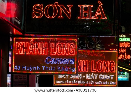 HO CHI MINH, VIETNAM - FEBRUARY 19: Different neon lights signs at night in the busy city of Ho Chi Minh City (Saigon). Vietnam 2016