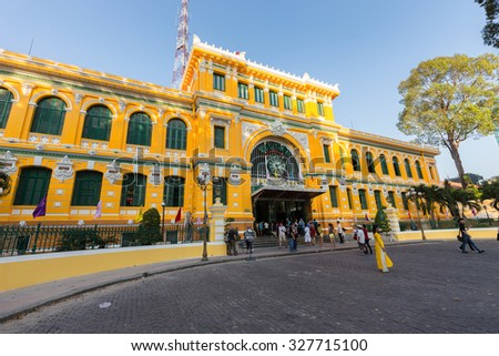 HO CHI MINH, VIETNAM, FEBRUARY 25, 2015 : Large view on the central French colonial style post office with tourist taking some photos in Ho Chi Minh city (Saigon), Vietnam