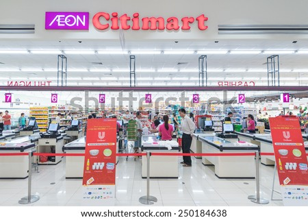 HO CHI MINH, VIETNAM - JAN 13, 2015: Unidentified people buy at a Citimart supermarket. Supermarkets are uncommon in Vietnam, open air markets and small businesses are the main players in retailing. - stock photo