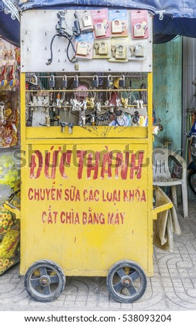 HO CHI MINH, VIETNAM - JAN 05, 2015: Vietnam keys are being copied by an old machine. this is a livelihood on streets in Ho Chi Minh city, Vietnam.