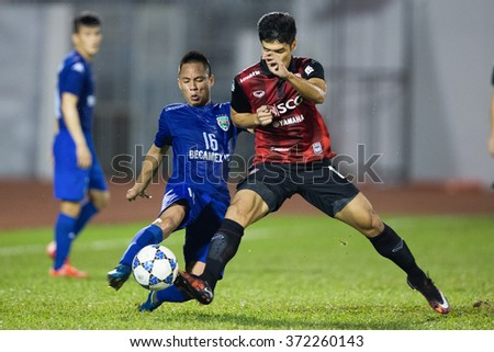 HO CHI MINH-VIETNAM JANUARY23:Nguyen Xuan Thanh (L) of Binh Duong in action during The SCG Muangthong Utd Asean Tour 2016 Binh Duong and Muangthong Utd at Thong Nhat Stadium on Jan23,2016 in Vietnam