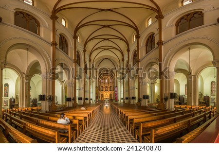 HO CHI MINH, VIETNAM - JANUARY, 02, 2014: panoramic view of Interior of Saigon Notre-Dame Basilica cathedral located in the downtown of Ho Chi Minh City, Vietnam - stock photo