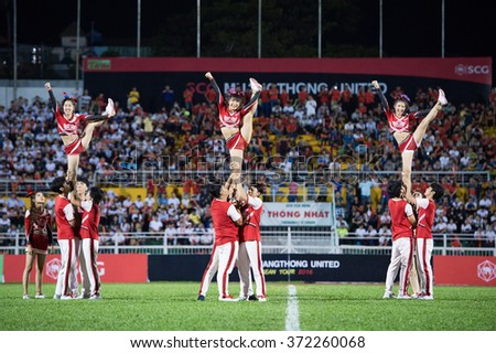 HO CHI MINH-VIETNAM JANUARY23:The cheerleaders of Vietnam perform during The SCG Muangthong Utd Asean Tour 2016 Binh Duong and Muangthong Utd at Thong Nhat Stadium on Jan23,2016 in Vietnam - stock photo