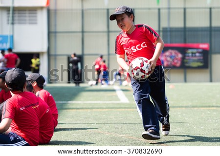 HO CHI MINH-VIETNAM JANUARY 23:Unidentified young local in action during Kick&Share ahead of our match against The SCG Muangthong United Asean Tour2016 at the Tao Dan Stadium on Jan23,2016 in Vietnam - stock photo