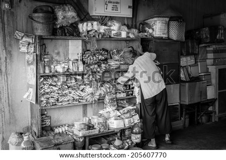 HO CHI MINH, VIETNAM - JULY 13: A Typical Street-Vendist Shop, on July 13, 2014 in Ho Chi Minh City. - stock photo