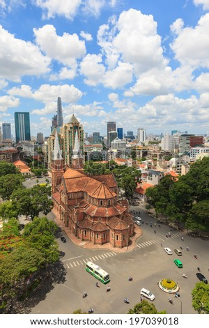 HO CHI MINH, VIETNAM - June 6, 2014: Notre Dame cathedral ( Duc Ba Church ) sunny and cloudy day view from the high , is a cathedral located in the downtown of Ho Chi Minh City. - stock photo