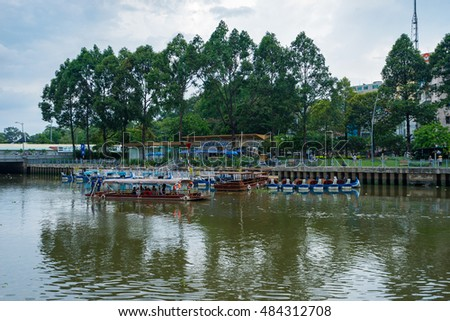 Ho Chi Minh, Vietnam - June 11, 2016: Tourist boats moving on the Nhieu Loc canal at Saigon. The tour is designed to go around the central districts around city via Nhieu Loc and Thi Nghe canal