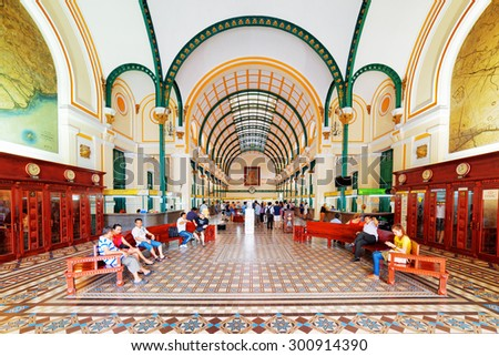 HO CHI MINH, VIETNAM - MAY 7, 2015: Interior of Saigon Central Post Office. Steel structure of building was designed by Gustave Eiffel. Ho Chi Minh is a popular tourist destination of Asia. - stock photo