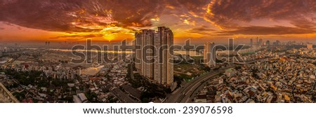HO CHI MINH, VIETNAM - NOVEMBER 01, 2014 : Aerial sunrise view of  HO CHI MINH downtown with SAIGON bridge and SAIGON river in the background. HO CHI MINH city is the biggest city in VIETNAM - stock photo