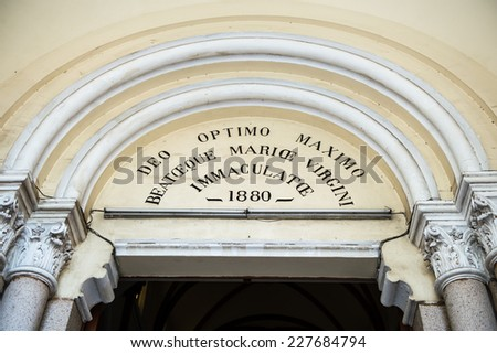 HO CHI MINH, VIETNAM - OCT 5, 2014:  Entrance into the Saigon Notre Dame Basilica (Basilica of Our Lady of The Immaculate Conception) in Hochiminh (Saigon). It was established by French colonists