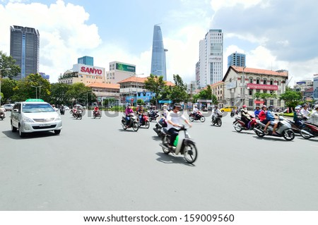 HO CHI MINH, VIETNAM - OCTOBER 5 : Motorcycle traffic on the street on October 5, 2013, in Ho Chi Minh, Vietnam. Is the largest city in Vietnam. Under the name Saigon
