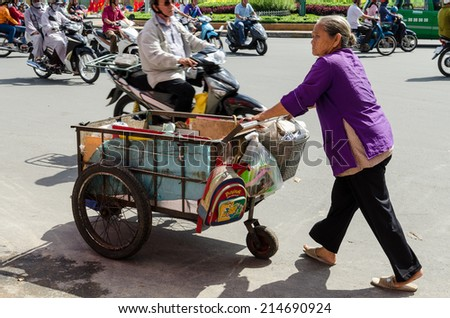 HO CHI MINH, VIETNAM - SEP 02: Unidentified bottle vendor on the street on September 02, 2014 in Ho Chi Minh city, Vietnam. - stock photo