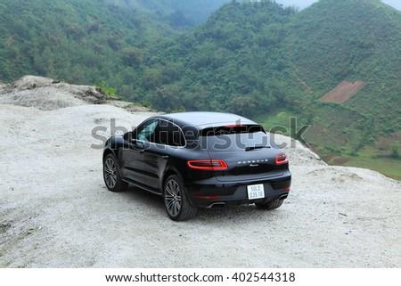 Hoa Binh, Viet Nam - March 27, 2015: Porsche Macan 2015 car running on the mountain road in Vietnam