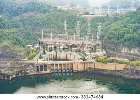 Hoa Binh, Vietnam - Jan 14, 2016: View of Hoa Binh Hydroelectricity Plant on misty day. The plant was built from 1979 with 8 machines provides 1920 MW, equal to one third of productivity of Vietnam.