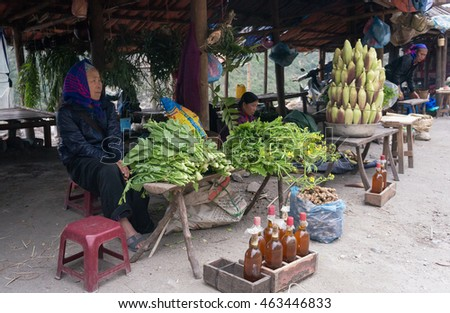 HOA BINH, Vietnam, March 12, 2016 Ethnic Thai woman, highland Hoa Binh, Vietnam, food products business, boiled corn. green vegetables