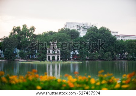 HoanKiem Lake, the little lake in the old part of Hanoi, Vietnam, with the Turtle Tower. Turtle Tower is the symbol of Hanoi,Vietnam. HoanKiem lake is center of Hanoi