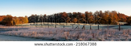 Hoarfrost covered meadow in early morning - stock photo