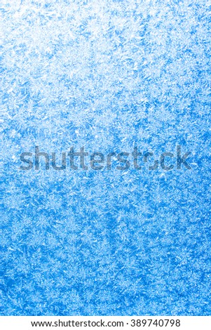 Hoarfrost on a window and sun come through - stock photo