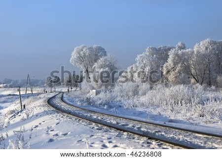 Hoarfrost on branches. Railway turn. Near to a railway crossing - stock photo